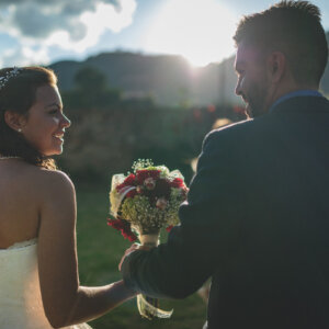 bride and groom hold bridal bouquet while walking in hacienda ya