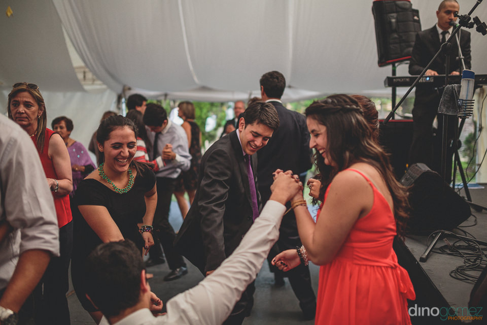 colombian band plays at wedding while guests dance