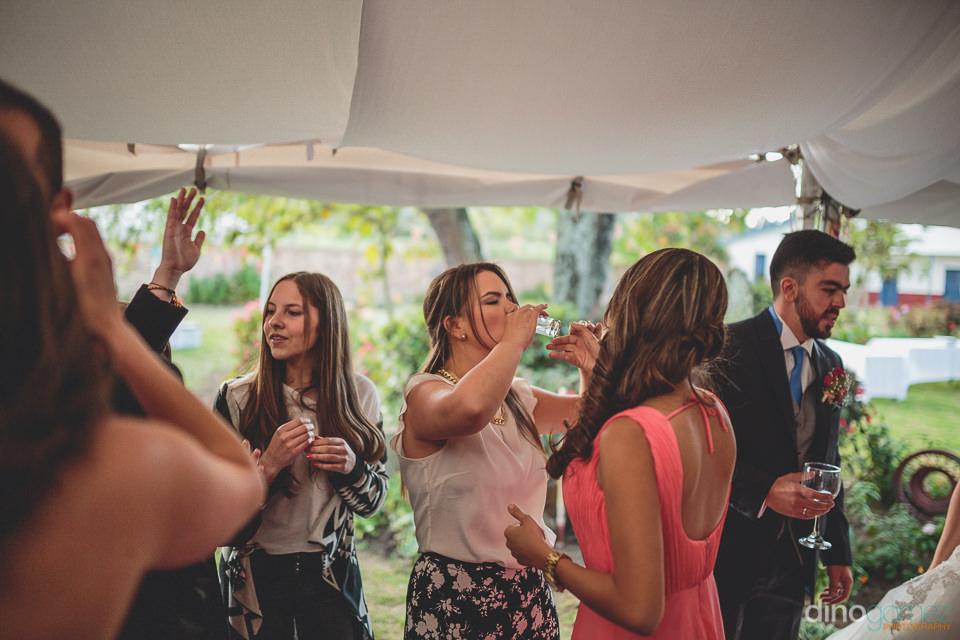 wedding guests drink colombian liquor