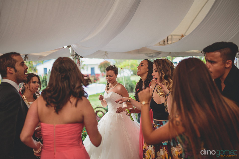 bride dances with friends at her wedding