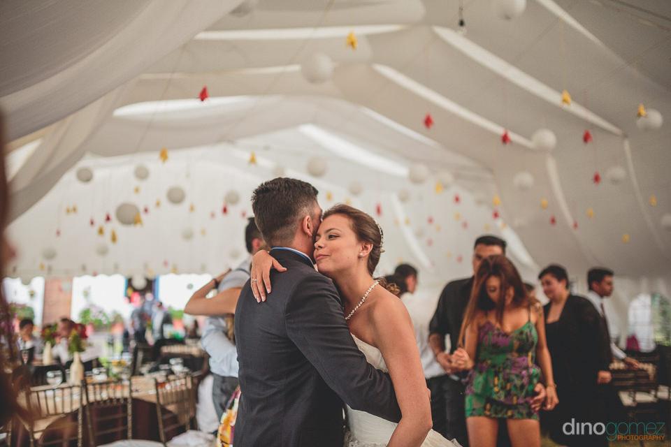 husband and wife hug and dance at their hacienda wedding photogr