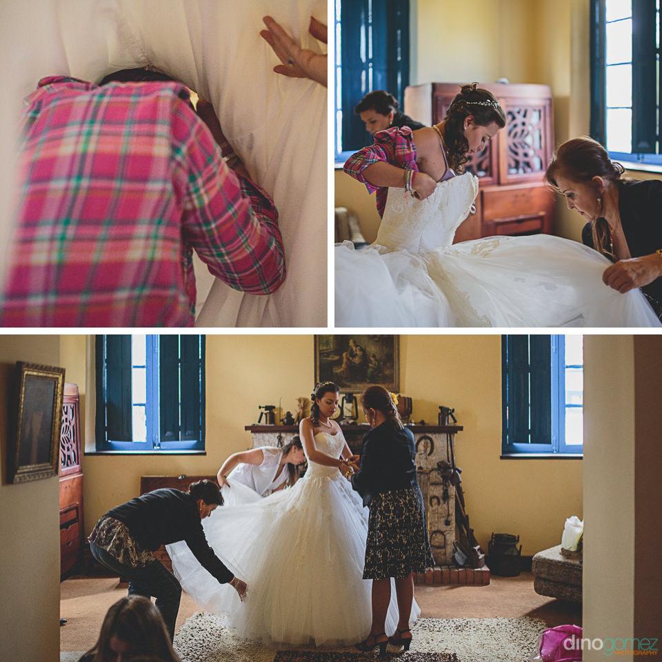 bride puts on her wedding dress
