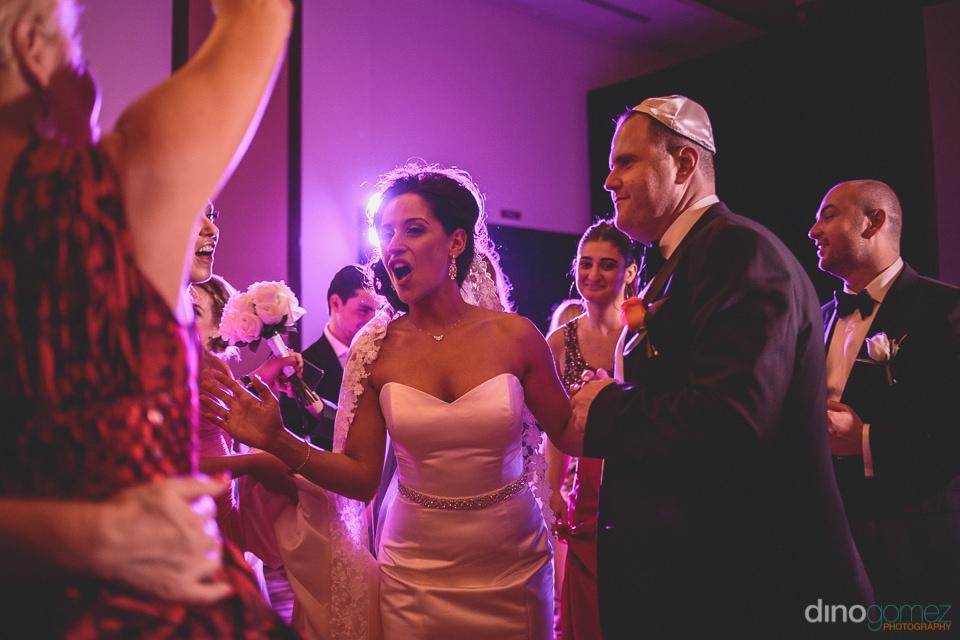 cabo jewish wedding bouquet toss photo by dino gomez
