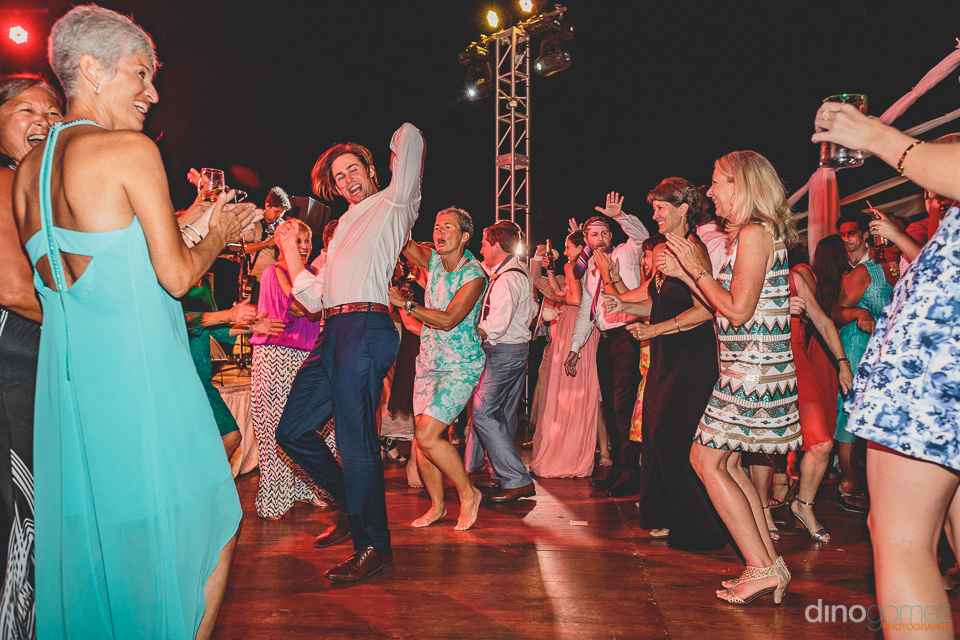 dino gomez photo of dancing wedding guests at cabo del sol resor