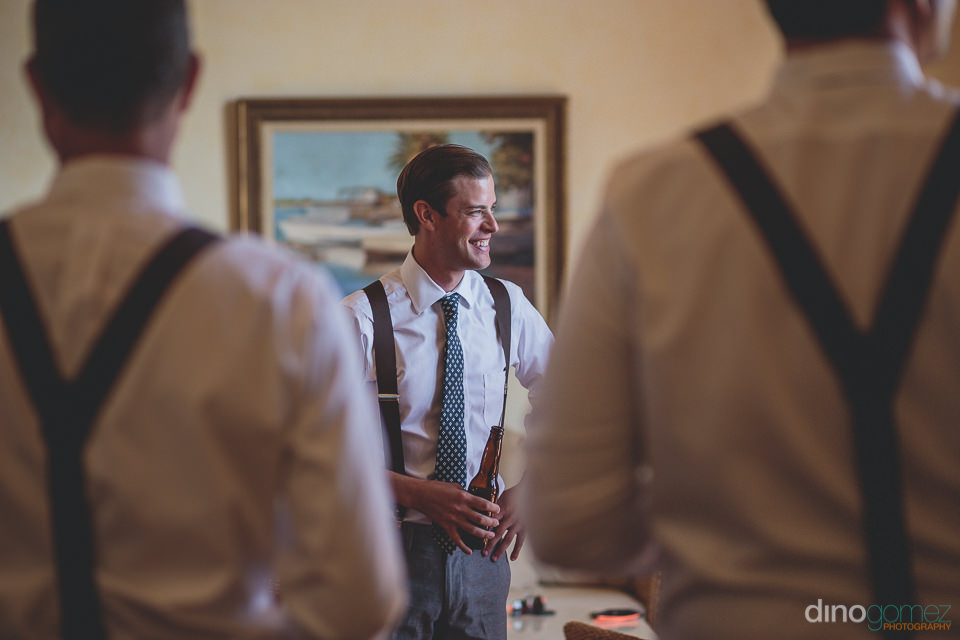 groom drinks beer before wedding