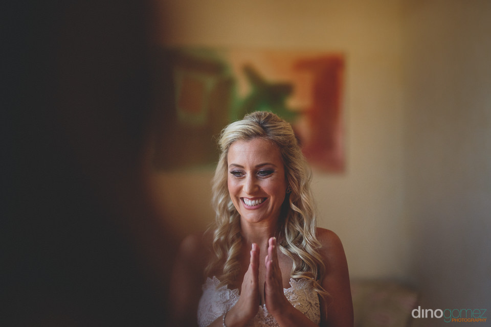 ecstatic bride smiles before her wedding ceremony