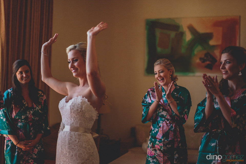 bridesmaids cheer for the bride