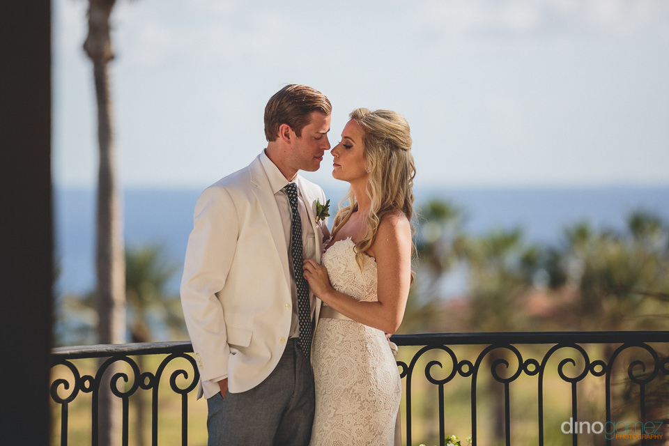 husband and wife embrace at cabo del sol resort