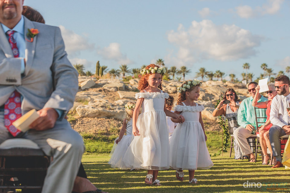 flower girls at beachside wedding ceremony