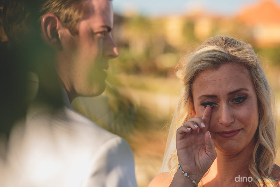 bride cries with joy at wedding photo by dino gomez and amy abbo