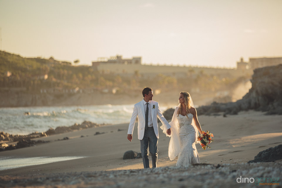 picturesque cabo beach with bride and groom