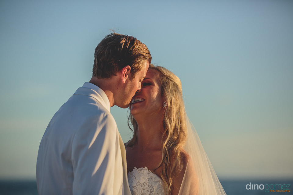 blue sky wedding kiss cabo san lucas