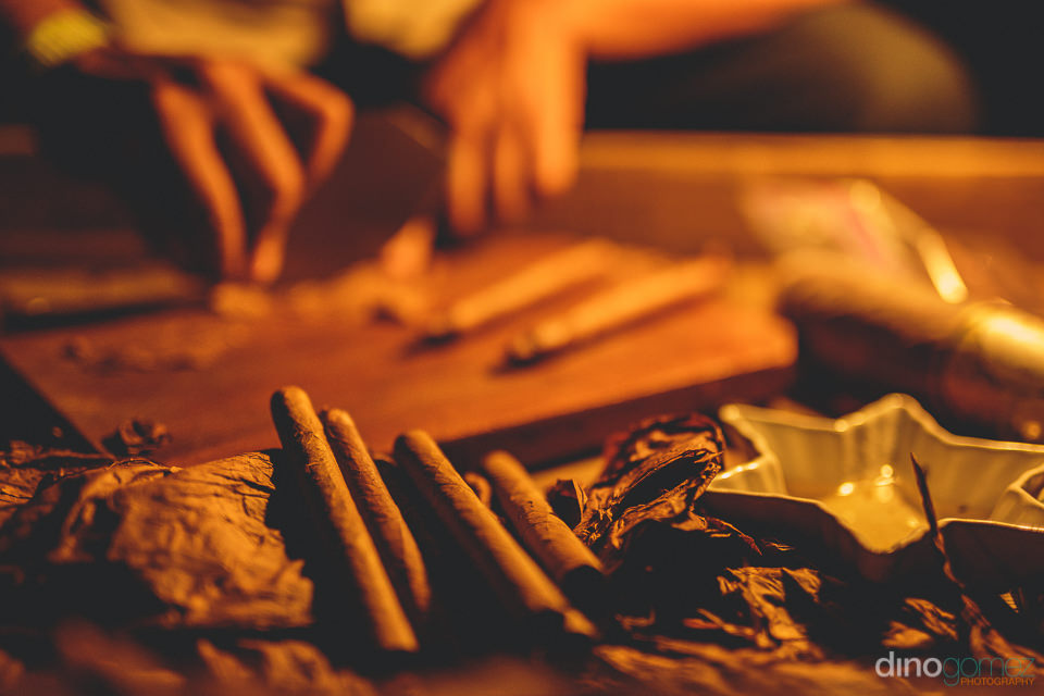 hand rolled cigars at cabo wedding photo by dino gomez