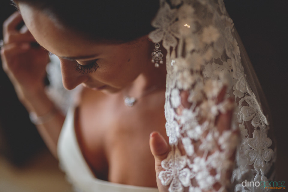 closeup photo of bride in white dress and wedding veil by jewish