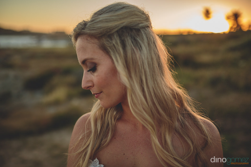 blonde bride at sunset after cabo san lucas wedding