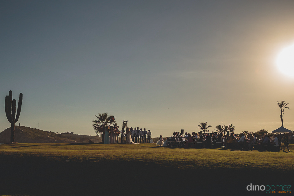 wide shot photo by dino gomez of wedding ceremony at cabo del so