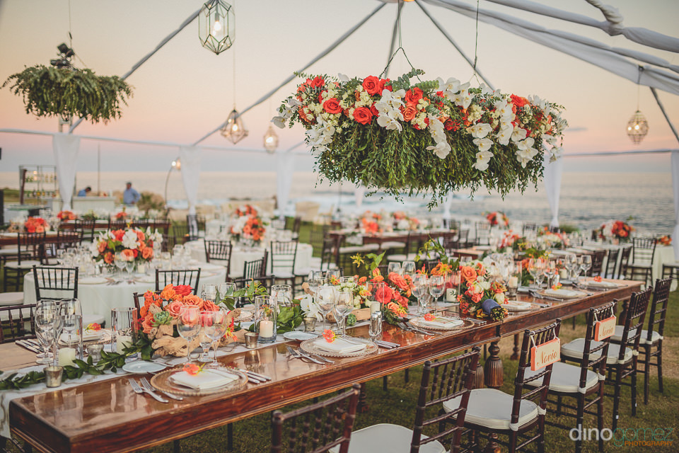 beautiful wedding dinner table with hanging flowers