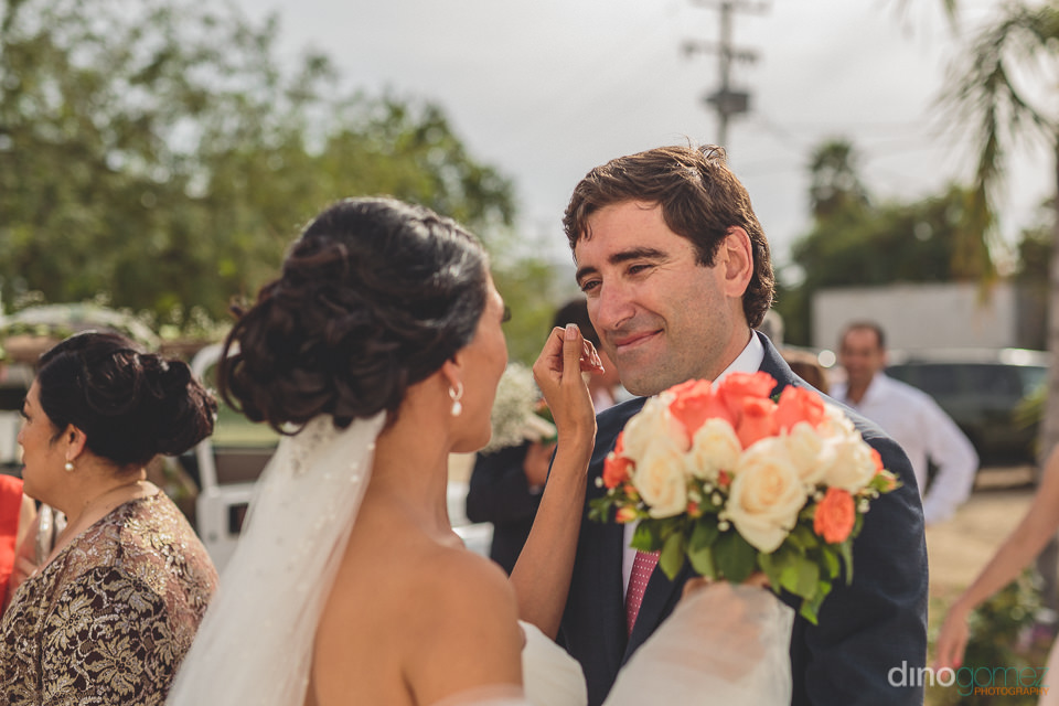 bride and groom smile before their church wedding in los cabos p