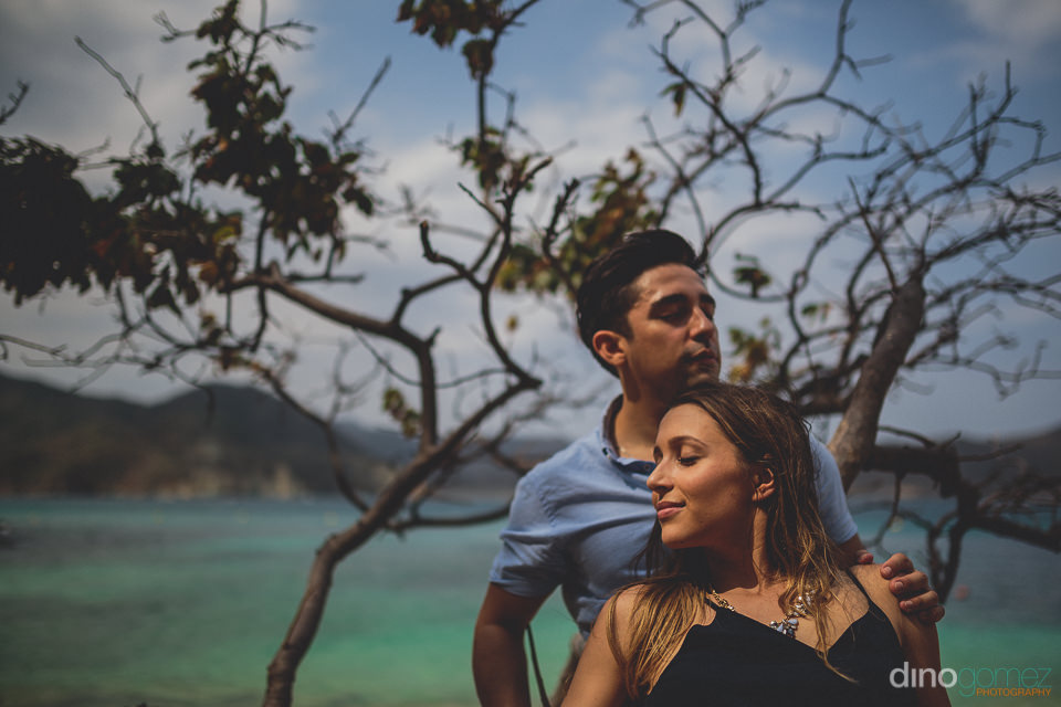 newlyweds in sunny tayrona national park colombia photo by dino