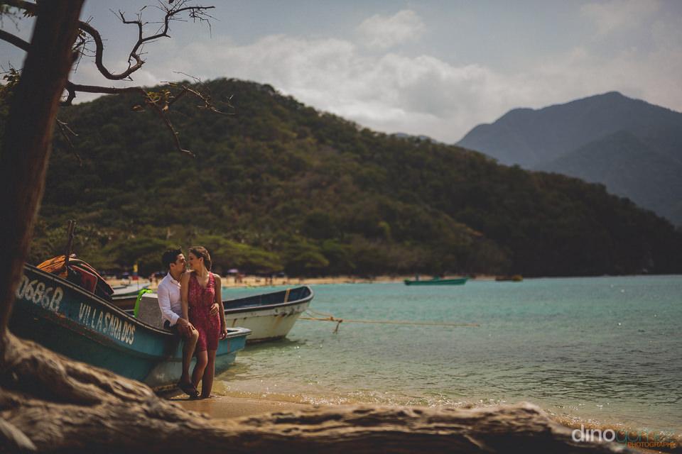 panga boats on the beach in tayrona national park colombia photo