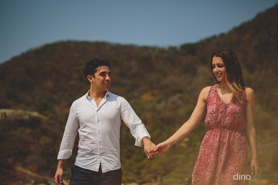 newlyweds walking on the beach in tayrona national park colombia