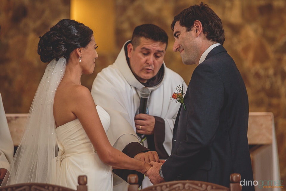 catholic priest officiates church wedding in los cabos mexico di