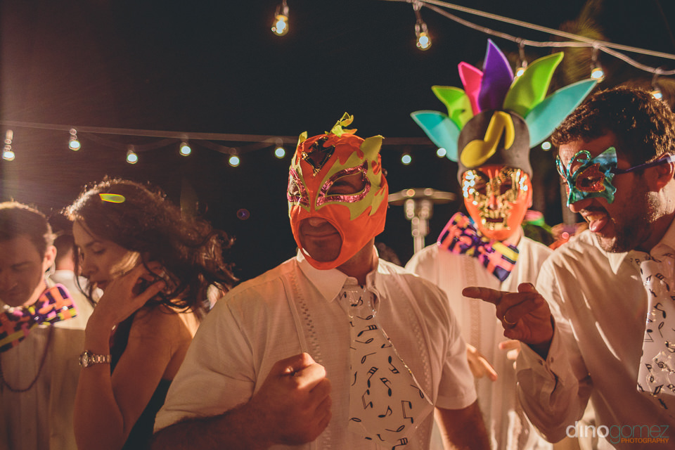 colorful fun masks at los cabos wedding photographed by dino gom