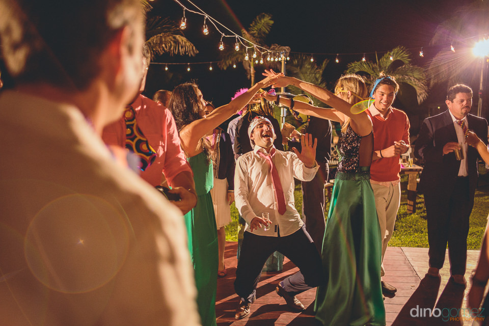claudia and jose wedding los cabos doing the limbo photo by dino
