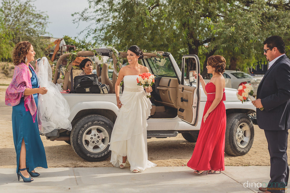 bride takes a jeep to her wedding in los cabos mexico