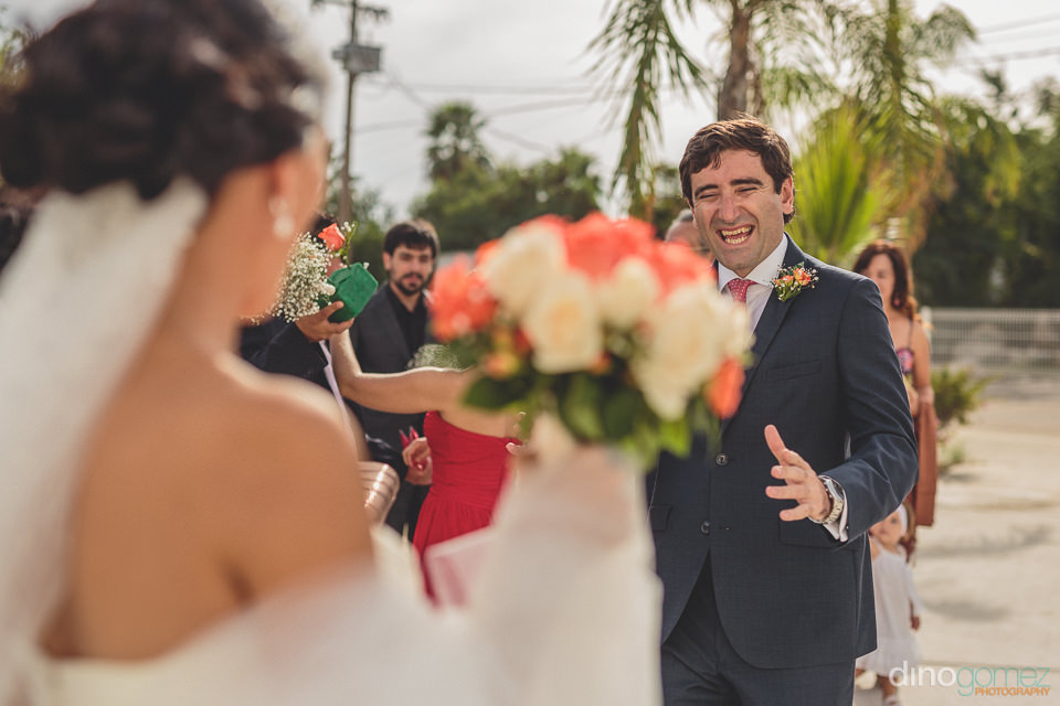 smiling groom greets his wife on their wedding day