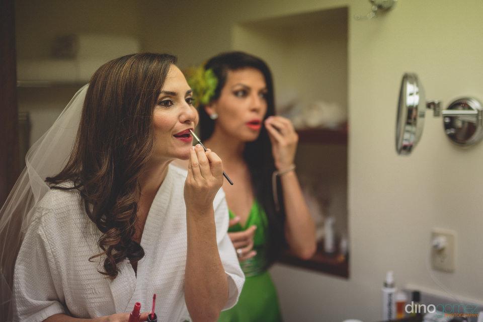 casa velas destination wedding bride puts on makeup