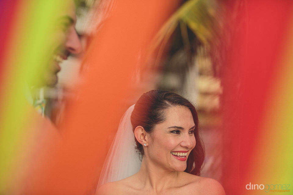 colorful photo by dino gomez of bride and groom at altar