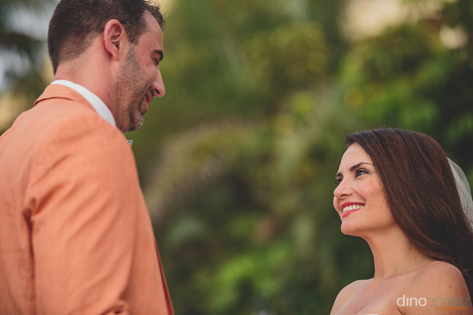 groom wears peach colored wedding suit photo by dino gomez photo