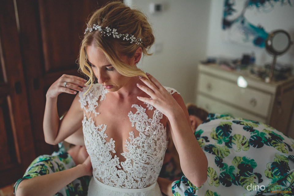 bridesmaid help bride put on her dress before cabo destination w