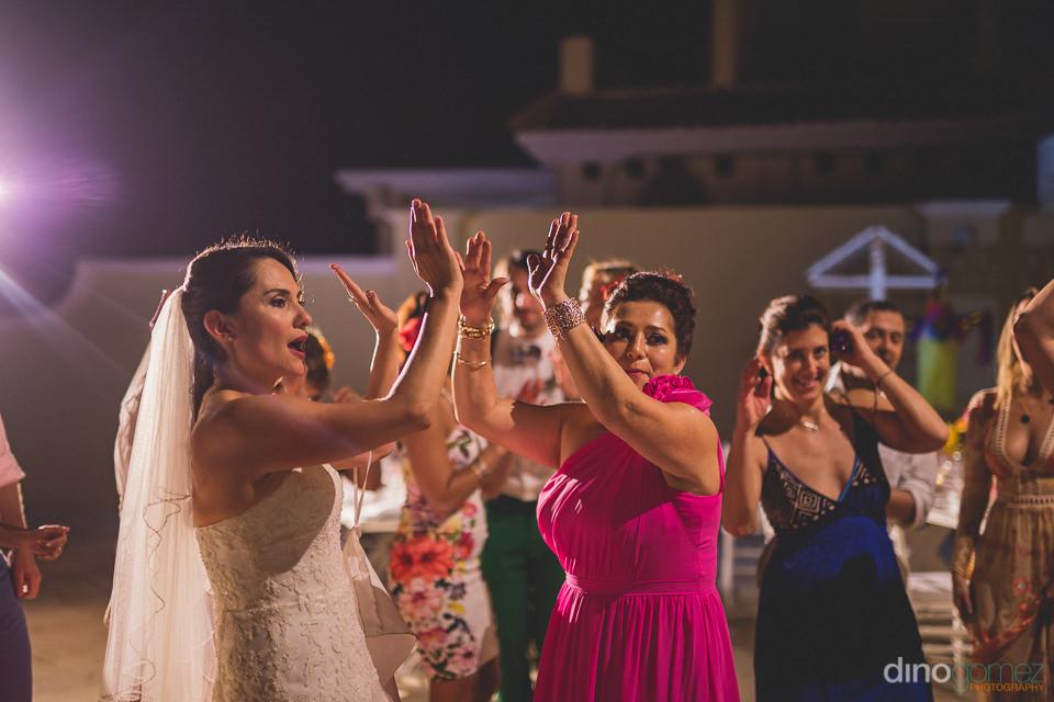 photo by dino gomez of bride dancing at casa velas puerto vallar