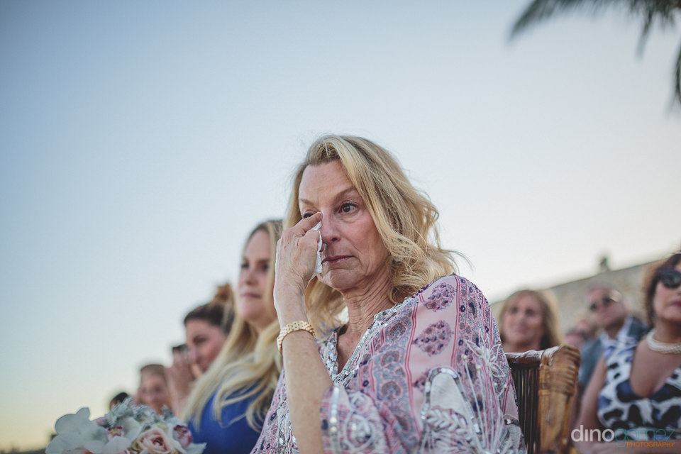 wedding guest cries during wedding ceremony on the beach in cabo