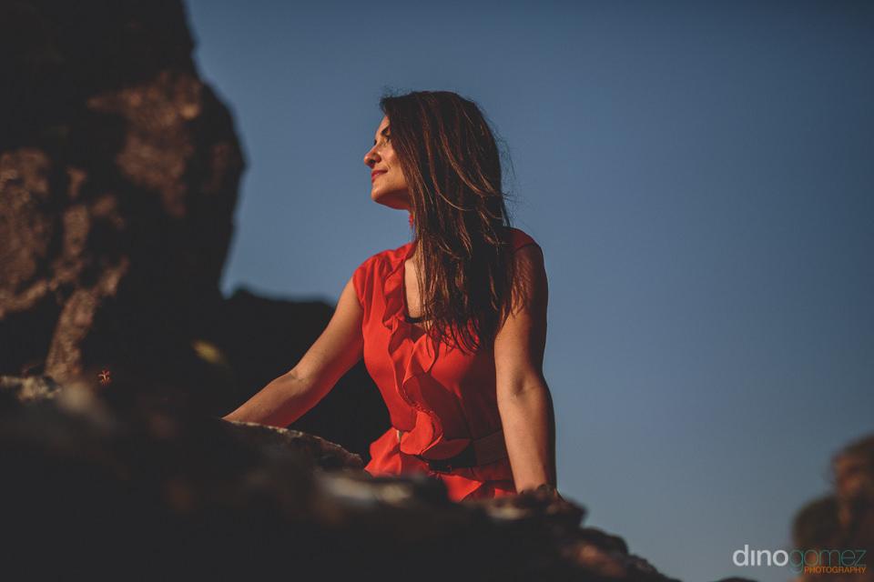 red dress bride on beach rocks in puerto vallarta photo by dino