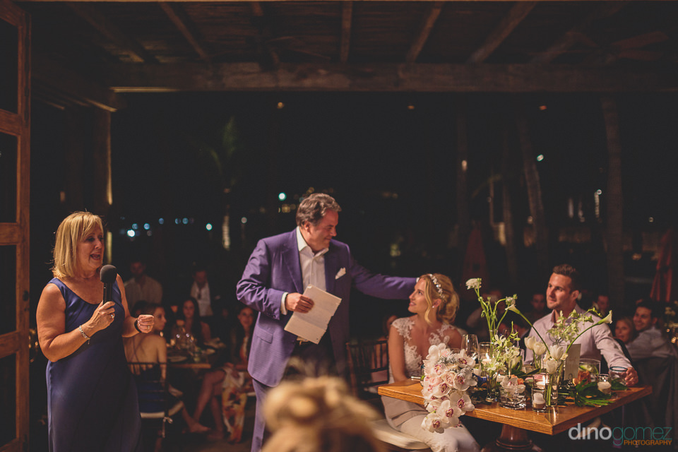 wedding guests speak at reception in los cabos photo by dino gom