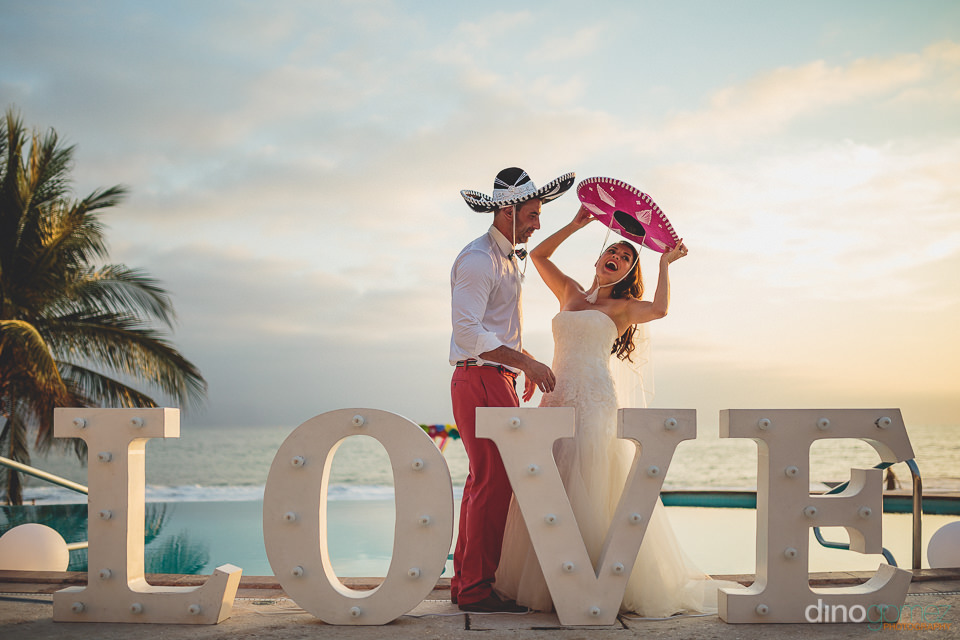 bride and groom wear mariachi hats in puerto vallarta photo by d