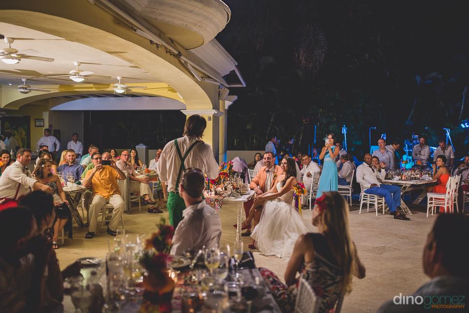 best man gives speech at destination wedding at casa velas resor