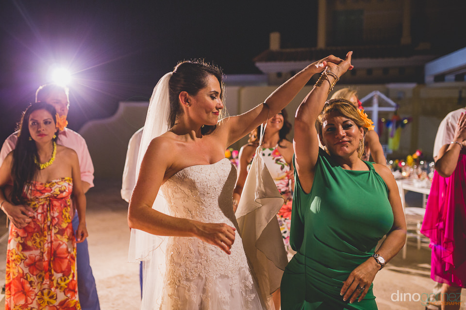 bride dances with friends during wedding at casa velas