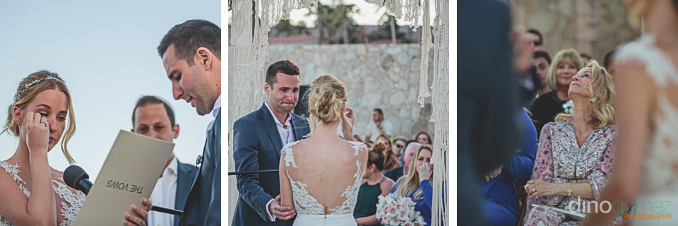 bride cries while reading her wedding vows at the beach altar