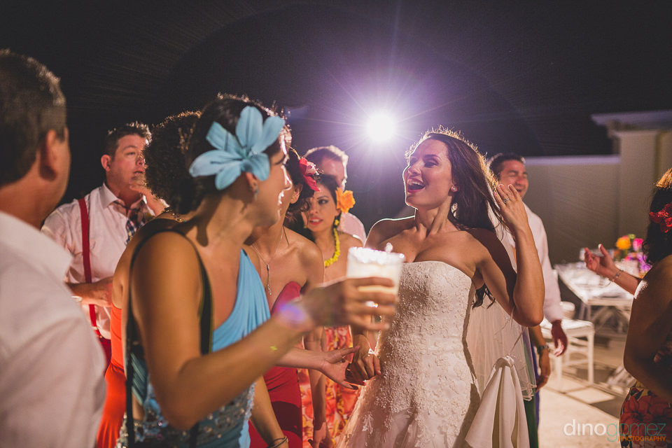 bride with guests under the spotlight during wedding reception