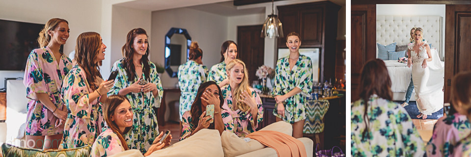 bridesmaids see bride in her wedding dress on wedding day