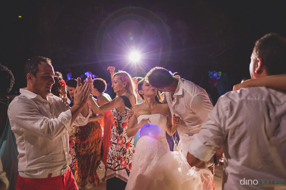 newlyweds kissing on dance floor wedding photos by dino gomez