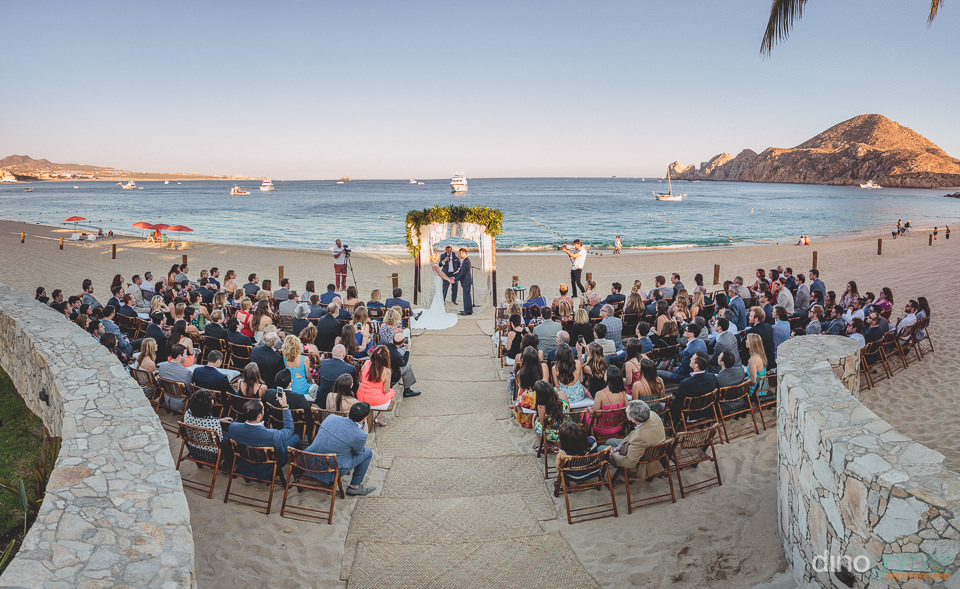 wide angle wedding photo by dino gomez of beach ceremony and med