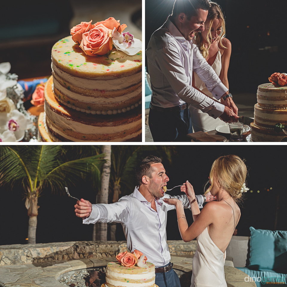 newlyweds cut cookie style cake during wedding dinner