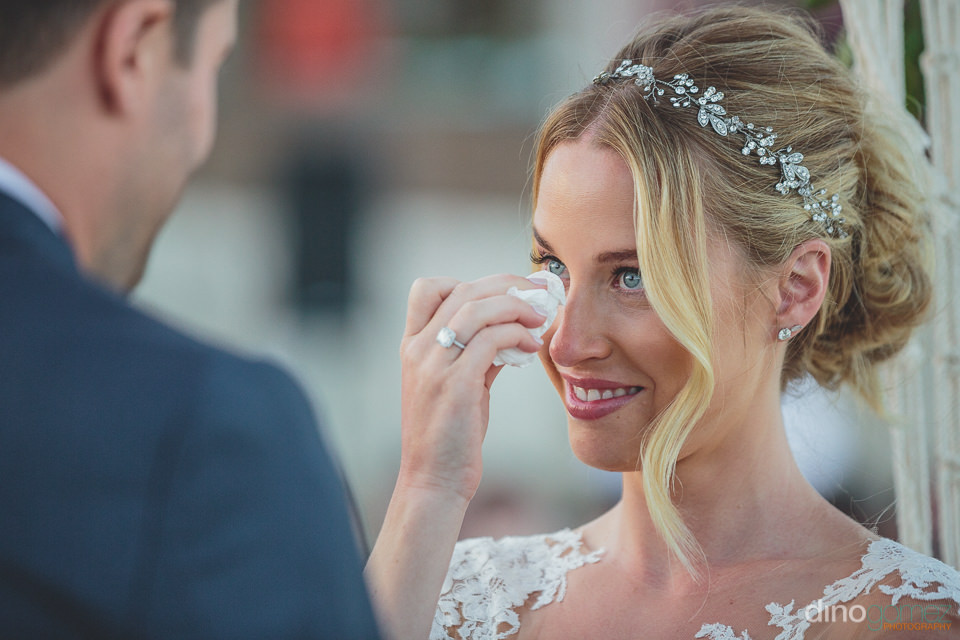 bride cries tears of joy during wedding photos by dino gomez