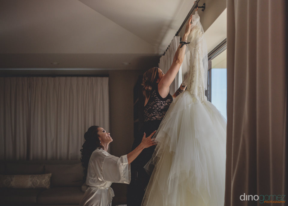 magnificent wedding dress hanging in window at jw marriott hotel