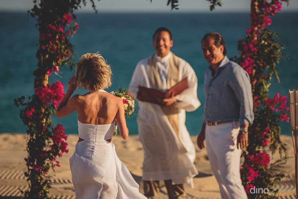 bride walks down aisle in cabo at private elope wedding ceremony